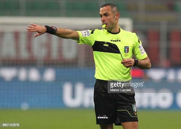 Referee Marco Guida gestures during the Serie A match between AC Milan and Bologna FC at Stadio Giuseppe Meazza on December 10 2017 in Milan Italy