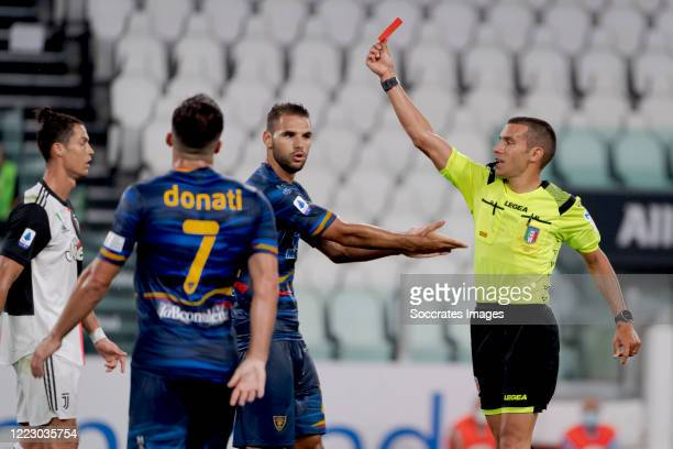 Referee Marco Piccinni gives a red card during the Italian Serie A match between Juventus v Lecce at the Allianz Stadium on June 26, 2020 in Turin...