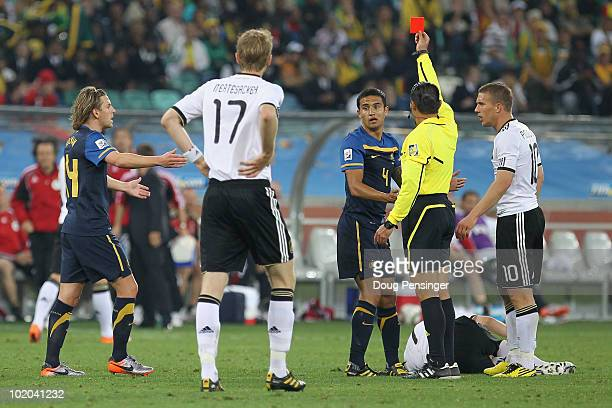 Referee Marco Rodriguez awards Tim Cahill of Australia a straight red card following a tackle on Bastian Schweinsteiger of Germany during the 2010...