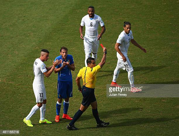 Referee Marco Rodriguez shows a red card to Claudio Marchisio of Italy during the 2014 FIFA World Cup Brazil Group D match between Italy and Uruguay...