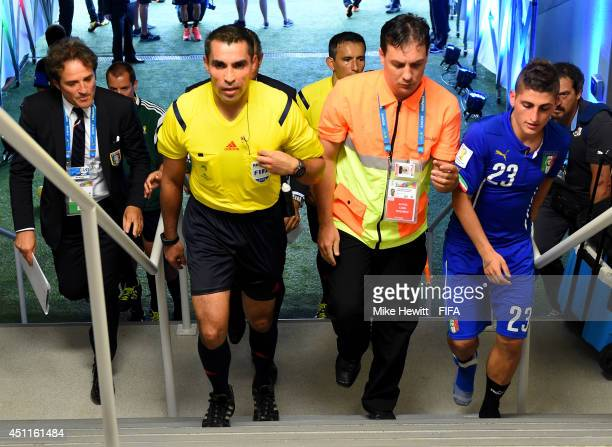 Referee Marco Rodriguez walks in the tunnel after the 2014 FIFA World Cup Brazil Group D match between Italy and Uruguay at Estadio das Dunas on June...