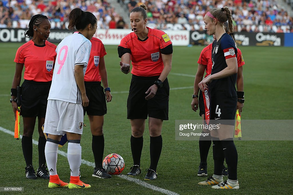 Referee Margaret Domka tosses the coin with team captains Yuki Ogimi #9 of Japan and Becky Sauerbrunn #4 of United States of America prior to their international friendly match at Dick's Sporting Goods Park on June 2, 2016 in Commerce City, Colorado. Japan and the United States played to a 3-3 draw.