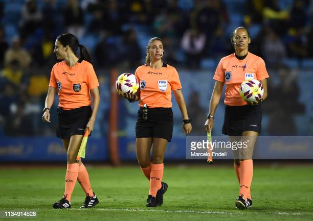 Referee Maria Laura Fortunato and assistant one Mariana Almeida and assistant two Analia Caballero gets into the pitch during a match between Boca...