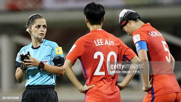 Referee Marianela Araya Cruz of Costa Rica directs Lee Ain of Korea Republic and Hong Hyeji during their Group D match in the FIFA U20 Women's World...