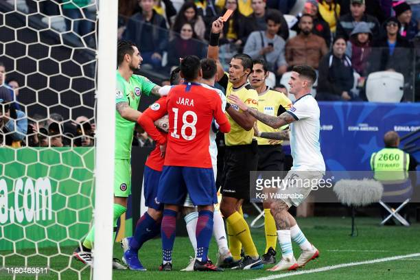 Referee Mario Diaz de Vivar shows a yellow card to Lionel Messi of Argentina and Gary Medel of Chile during the Copa America Brazil 2019 Third Place...