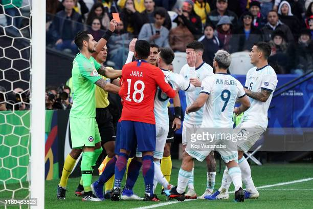 Referee Mario Diaz de Vivar shows a yellow card to Lionel Messi of Argentina during the Copa America Brazil 2019 Third Place match between Argentina...