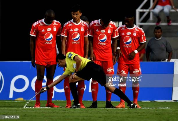 Referee Mario Herrera uses foam spray during a match between America de Cali and Deportes Tolima as part of Liga Aguila I 2018 at Pascual Guerrero...