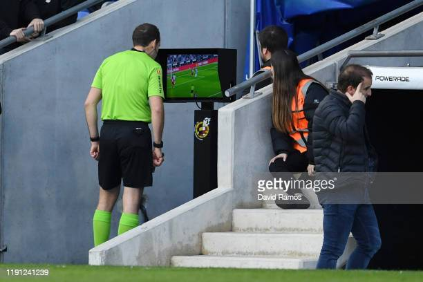 Referee Mario Lopez checks the VAR screen before he awards a penalty to Espanyol during the La Liga match between RCD Espanyol and CA Osasuna at RCDE...