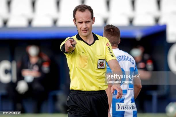Referee Mario Melero gives a penalty during the La Liga Santander match between Leganes v Valencia at the Estadio Municipal de Butarque on July 12,...