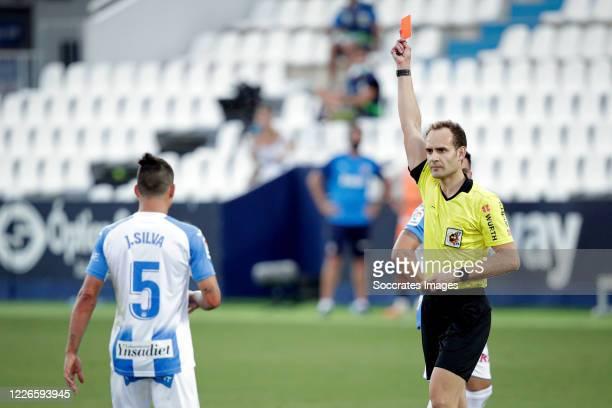Referee Mario Melero gives a red card to Jonathan Silva of Leganes during the La Liga Santander match between Leganes v Valencia at the Estadio...