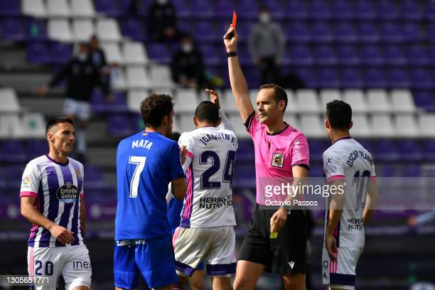 Referee Mario Melero Lopez awards Jaime Mata of Getafe CF a red card during the La Liga Santander match between Real Valladolid CF and Getafe CF at...