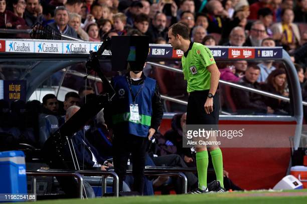Referee Mario Melero Lopez checks the VAR screen and awards a penalty kick for FC Barcelona during the La Liga match between FC Barcelona and...