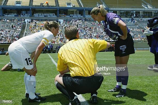 Referee Mark Arblaster participates in pregame festivities with Brandi Chastain of the San Jose Cyberrays and Tiffeny Milbrett of the New York Power...
