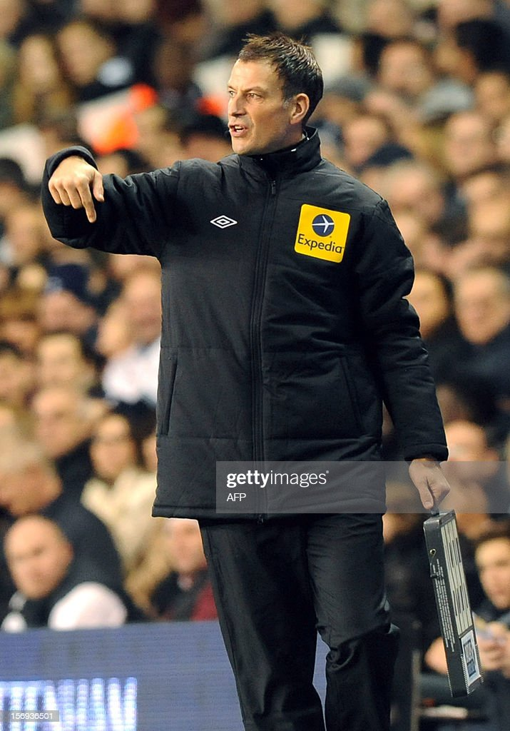 """Referee Mark Clattenburg, 4th official, gestures during the English Premier League football match between Tottenham Hotspurs and West Ham at White Hart Lane in North London on November 25, 2012. Clattenburg made his return as the fourth official at White Hart Lane, in his first engagement since he was cleared by the Football Association over allegations he racially abused Chelsea midfielder John Obi Mikel. USE. No use with unauthorized audio, video, data, fixture lists, club/league logos or """"live"""" services. Online in-match use limited to 45 images, no video emulation. No use in betting, games or single club/league/player publications."""