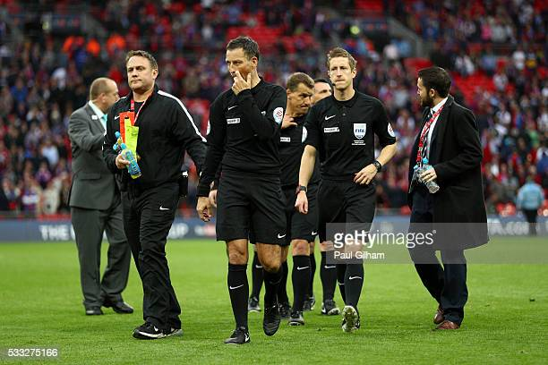 Referee Mark Clattenburg and officials look on after The Emirates FA Cup Final match between Manchester United and Crystal Palace at Wembley Stadium...