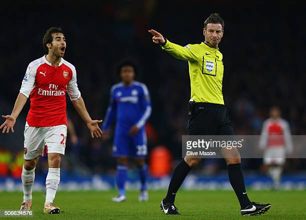 Referee Mark Clattenburg gestures during the Barclays Premier League match between Arsenal and Chelsea at The Emirates Stadium on January 24 2016 in...