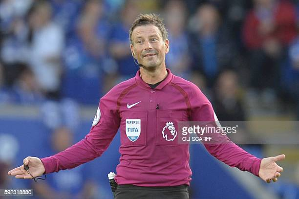 Referee Mark Clattenburg gestures during the English Premier League football match between Leicester City and Arsenal at King Power Stadium in...