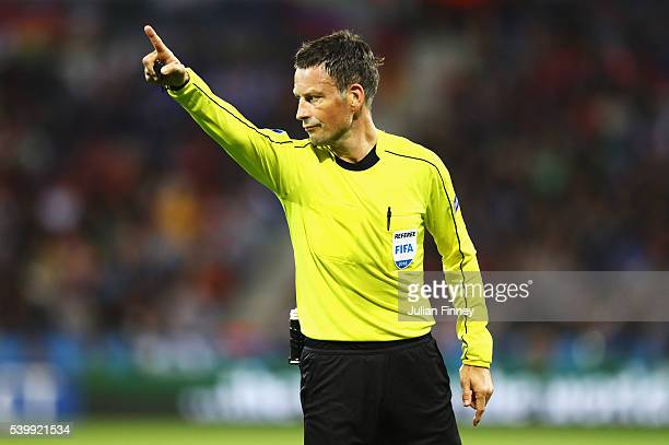 Referee Mark Clattenburg gestures during the UEFA EURO 2016 Group E match between Belgium and Italy at Stade des Lumieres on June 13 2016 in Lyon...