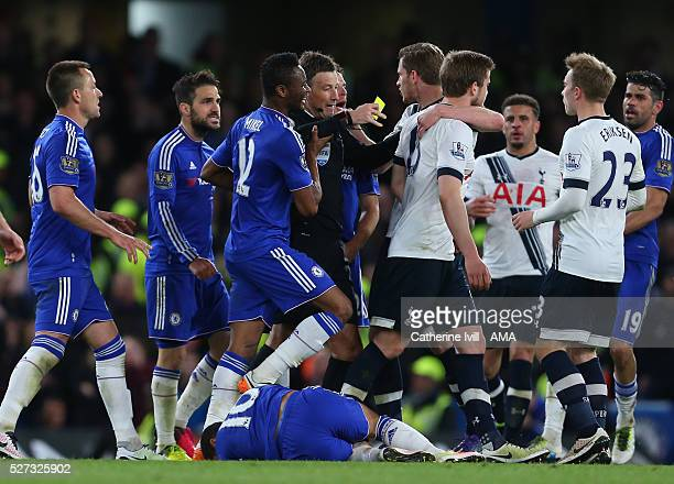 Referee Mark Clattenburg gets caught up in the melee as Eden Hazard of Chelsea lies injured during the Barclays Premier League match between Chelsea...