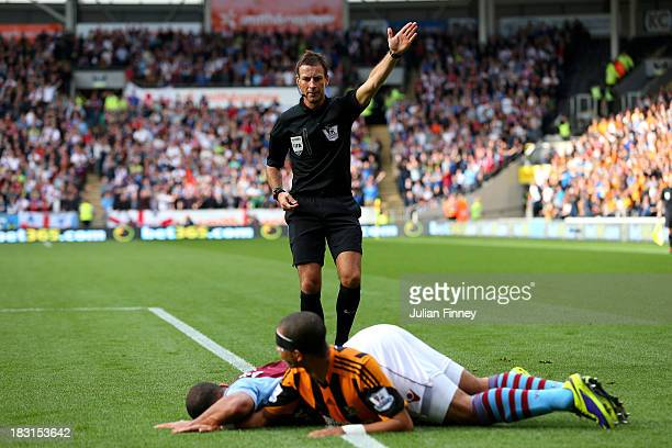 Referee Mark Clattenburg gives a free kick as Liam Rosenior of Hull brings down Gabriel Agbonlahor of Aston Villa during the Barclays Premier League...