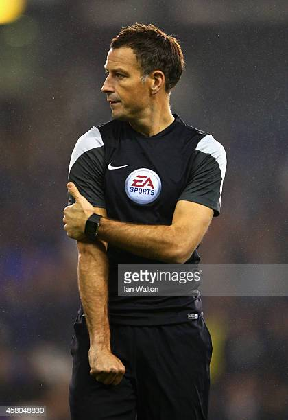 Referee Mark Clattenburg looks on prior to the Capital One Cup Fourth Round match Tottenham Hotspur and Brighton Hove Albion at White Hart Lane on...