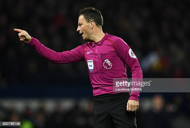 Referee Mark Clattenburg makes his point during the Premier League match between West Bromwich Albion and Hull City at The Hawthorns on January 2...