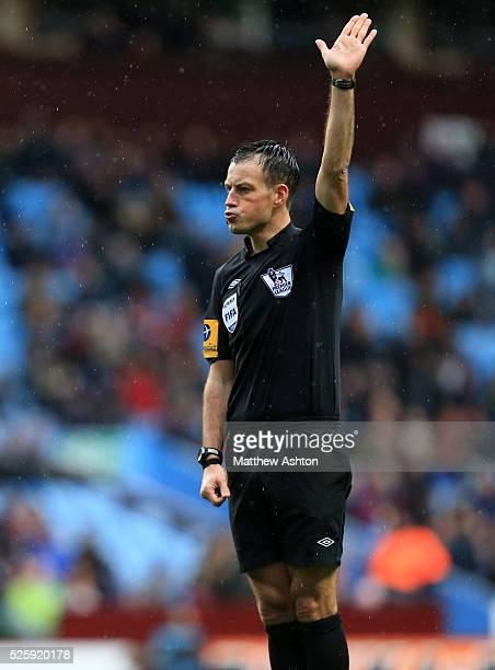 Referee Mark Clattenburg pulls a face