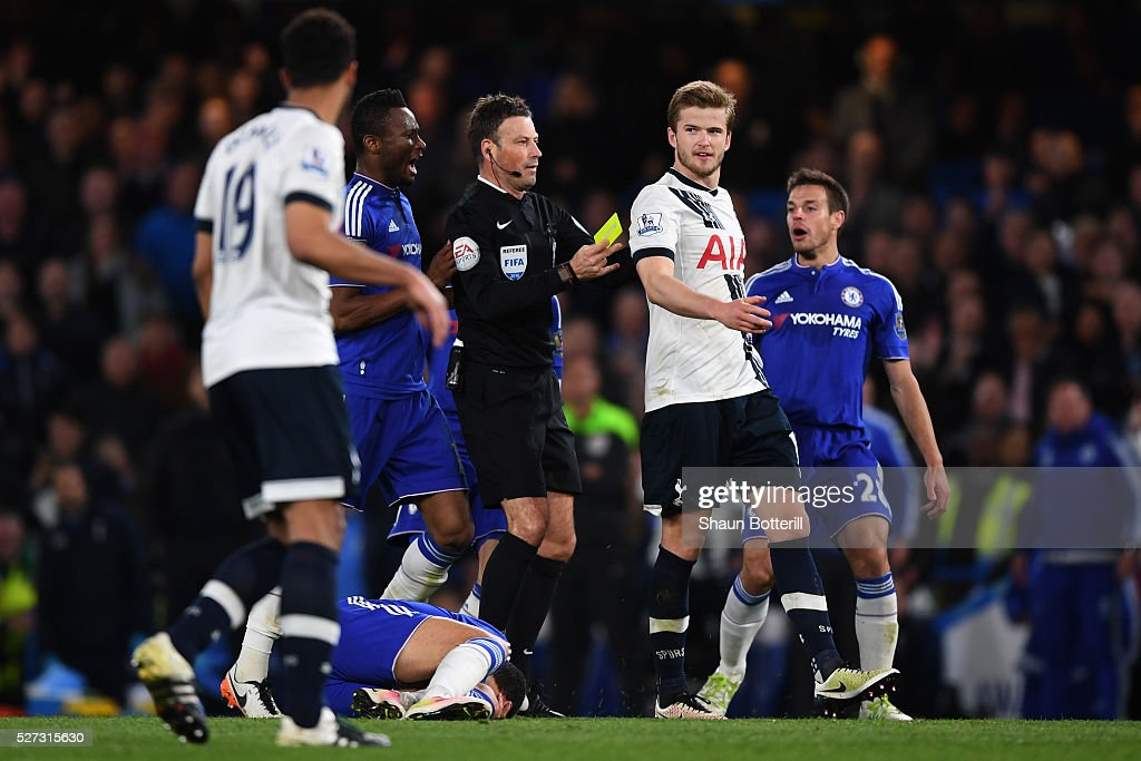 Referee Mark Clattenburg shows a yellow card to Eric Dier of Tottenham Hotspur after bringing down Eden Hazard of Chelsea during the Barclays Premier League match between Chelsea and Tottenham Hotspur at Stamford Bridge on May 02, 2016 in London, England.jd