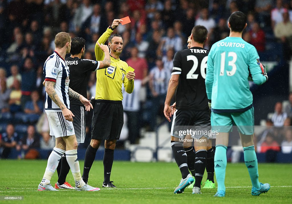 Referee Mark Clattenburg shows the red card to John Terry of Chelsea during the Barclays Premier League match between West Bromwich Albion and Chelsea at The Hawthorns on August 23, 2015 in West Bromwich, England.