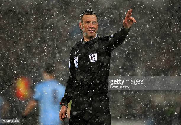 Referee Mark Clattenburg signals during the Barclays Premier League match between West Bromwich Albion and Manchester City at The Hawthorns on...
