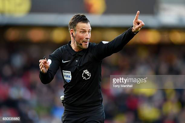 Referee Mark Clattenburg signals during the Premier League match between Watford and Crystal Palace at Vicarage Road on December 26 2016 in Watford...
