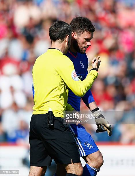 Referee Mark Clattenburg talks to goalkeeper Ben Foster of West Brom during the Barclays Premier League match between AFC Bournemouth and West...