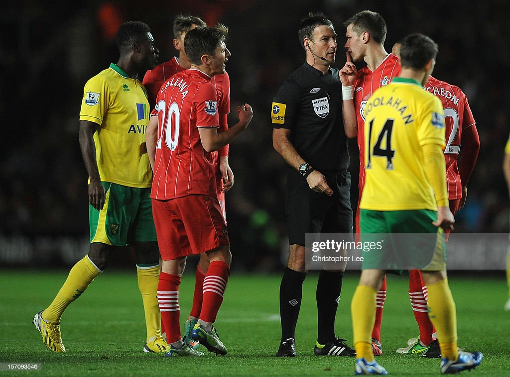 Referee Mark Clattenburg talks to Morgan Schneiderlin of Southampton and other players during the Barclays Premier League match between Southampton and Norwich City at St Mary's Stadium on November 28, 2012 in Southampton, England.