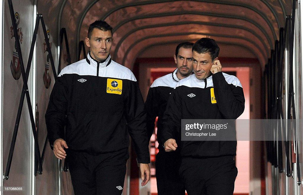 Referee Mark Clattenburg (R) walks out onto the pitch with his two assistants as they warm up during the Barclays Premier League match between Southampton and Norwich City at St Mary's Stadium on November 28, 2012 in Southampton, England.