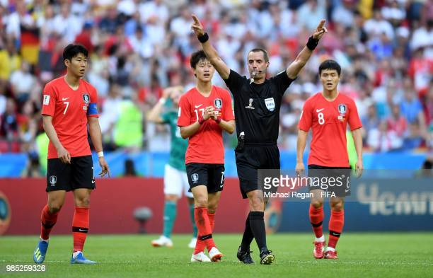 Referee Mark Geiger announces hes going to VAR during the 2018 FIFA World Cup Russia group F match between Korea Republic and Germany at Kazan Arena...