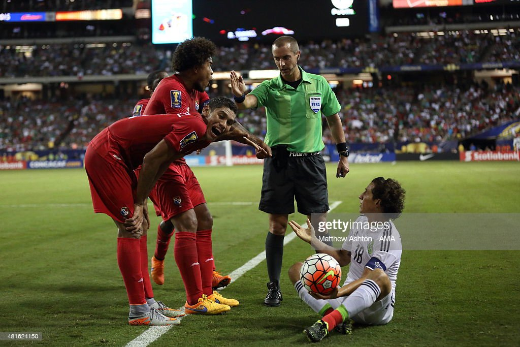 Referee Mark Geiger awards a free kick in favour of Andres Guardado of Mexico despite protests from Roman Torres of Panama during the CONCACAF Gold Cup Semi Final between Panama and Mexico at Georgia Dome on July 22, 2015 in Atlanta, Georgia.