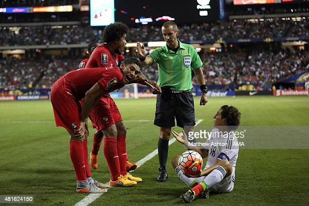 Referee Mark Geiger awards a free kick in favour of Andres Guardado of Mexico despite protests from Roman Torres of Panama during the CONCACAF Gold...