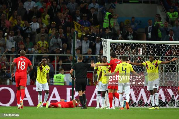 Referee Mark Geiger awards England a penalty following a foul on Harry Kane of England by Carlos Sanchez of Colombia during the 2018 FIFA World Cup...