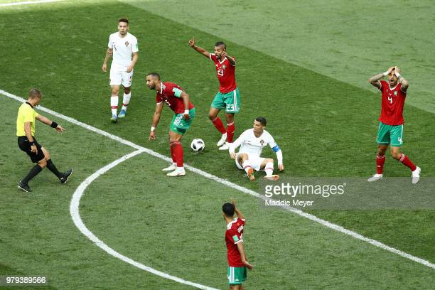 Referee Mark Geiger awards Portugal with a free kick following a foul by Mehdi Benatia of Morocco on Cristiano Ronaldo of Portugal during the 2018...