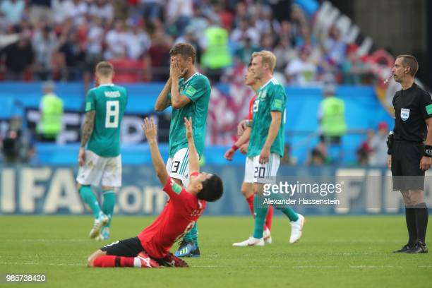 Referee Mark Geiger ends the match whilst Thomas Mueller of Germany and Sejong Ju of Korea Republic reacts during the 2018 FIFA World Cup Russia...