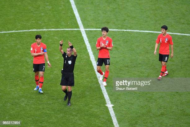 Referee Mark Geiger gestures for VAR during the 2018 FIFA World Cup Russia group F match between Korea Republic and Germany at Kazan Arena on June 27...