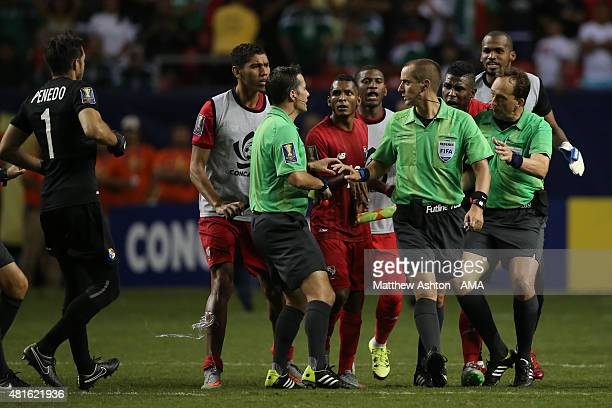 Referee Mark Geiger is confronted by Panama players after the Gold Cup Semi Final between Panama and Mexico at Georgia Dome on July 22 2015 in...