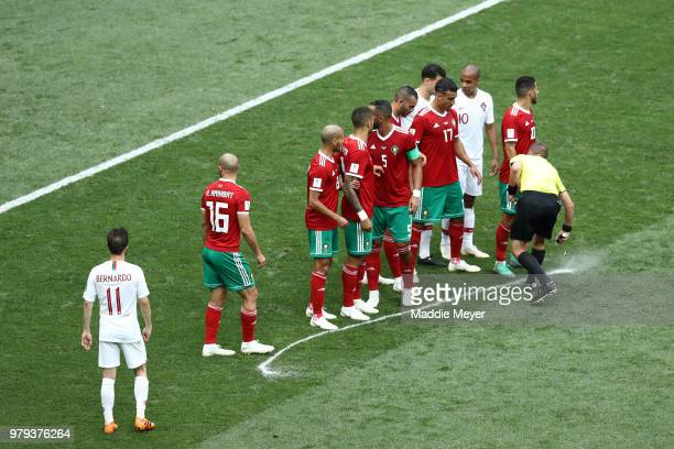 Referee Mark Geiger marks with spray the wall distance during the 2018 FIFA World Cup Russia group B match between Portugal and Morocco at Luzhniki...