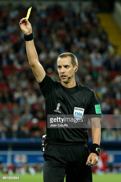 Referee Mark Geiger of USA gives a yellow card during the 2018 FIFA World Cup Russia Round of 16 match between Colombia and England at Spartak...