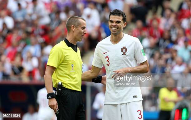 Referee Mark Geiger of USA Pepe of Portugal during the 2018 FIFA World Cup Russia group B match between Portugal and Morocco at Luzhniki Stadium on...