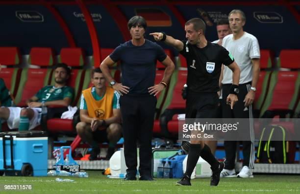 Referee Mark Geiger reacts as Joachim Loew Manager of Germany looks on during the 2018 FIFA World Cup Russia group F match between Korea Republic and...