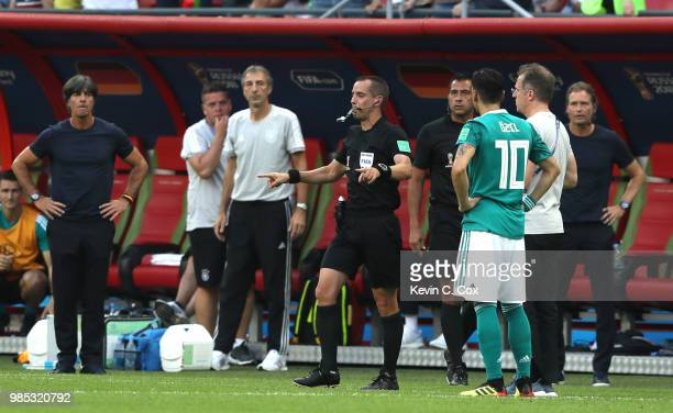 Referee Mark Geiger reviewis VAR footage for a possible offside of Younggwon Kim of Korea Republic's goal during the 2018 FIFA World Cup Russia group...