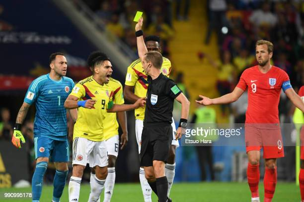 Referee Mark Geiger shows an yellow card to Radamel Falcao during the 2018 FIFA World Cup Russia Round of 16 match between Colombia and England at...