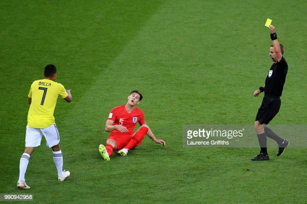 Referee Mark Geiger shows the yellow card to Carlos Bacca of Colombia during the 2018 FIFA World Cup Russia Round of 16 match between Colombia and...