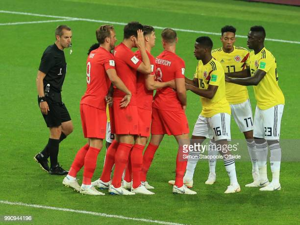 Referee Mark Geiger watches as the Colombian players try to halt the England attackers at a corner kick during the 2018 FIFA World Cup Russia Round...